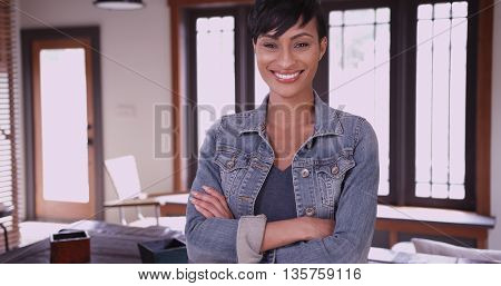 Happy Smiling Woman Homeowner Standing In Living Room