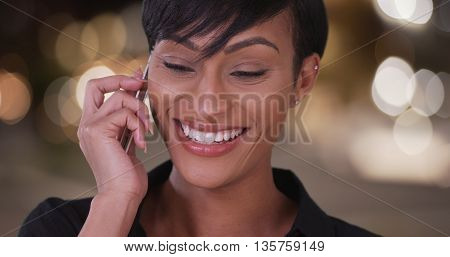 Happy Smiling Black Woman Talking On Mobile Phone On City Street Outdoors At Night