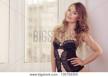 Fashion people erotic clothing concept. Nice girl with night clothes. Young lady has black corset.