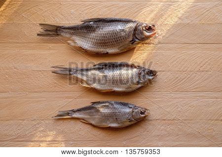 Dried Fish On A Wooden Background