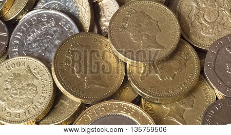 A lot of shiny British coin pounds