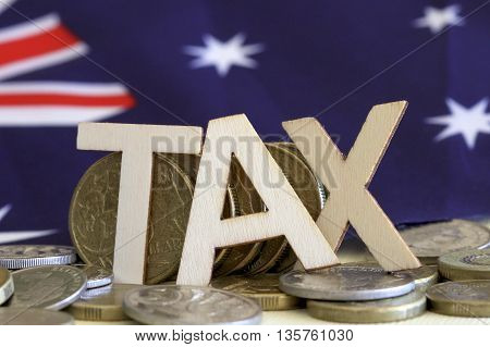Tax sign with a background of Australian dollars and flag.
