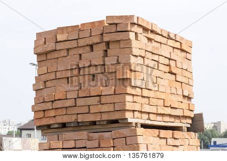 conventional pallet of red bricks on a pallet
