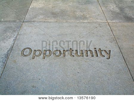 A photo of opportunity etched in the sidewalk