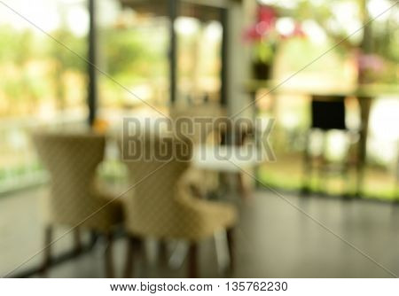 blur couple chairs and table in cafe background
