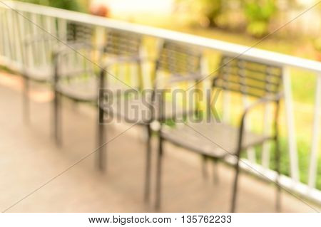 blur row silver color metal chairs on balcony