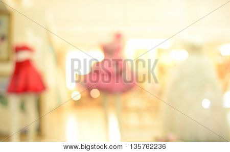 blur woman dress on window shopping background