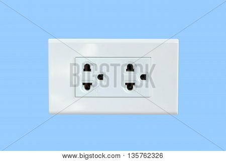 AC power plug isolated on blue background.