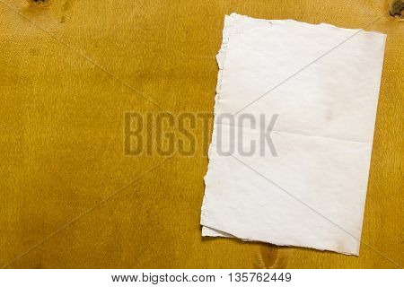 Dirty old sheet of paper on wooden background