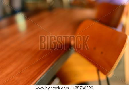 blur wood chair and table cafe interior