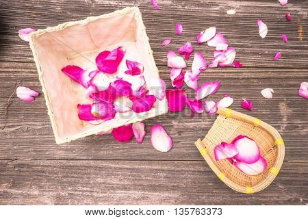 petals of red rose on old table