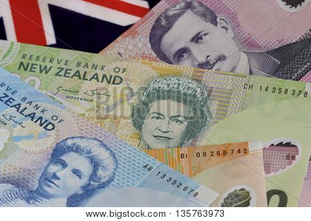Selection of New Zealand money and a flag.