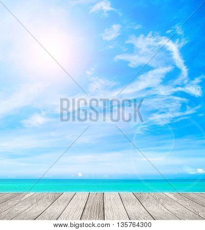 tropical beach with plank on blue sky background.