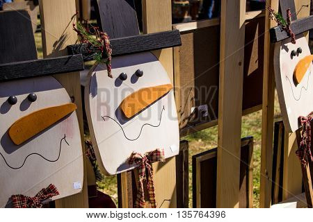 Wooden snowman for sale at craft fair