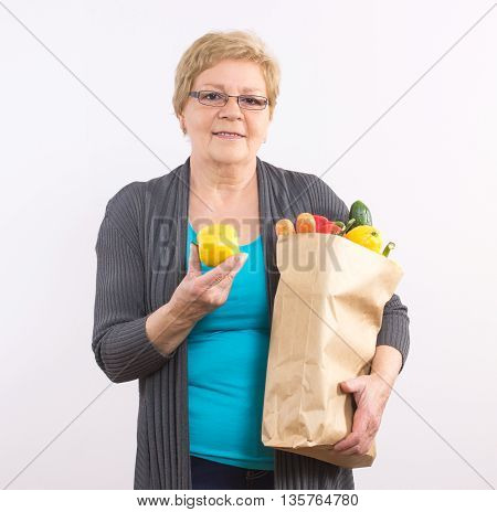 Happy Senior Woman Holding Fruits And Vegetables In Bag, Healthy Nutrition In Old Age