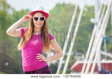 Happy Girl With Straw Hat And Sunglasses In Port With Yacht In Background, Summer Time
