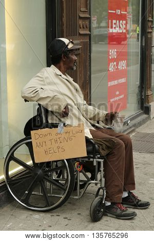 NEW YORK - JUNE 16, 2016: Homeless man at Greenwich Village in Lower Manhattan