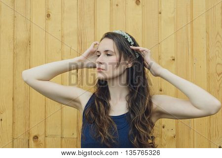 flowers branches spirea on a head young girl