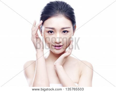 studio portrait of a young asian woman isolated on white.