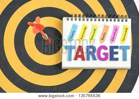 handwriting timely achievable relevant goals education teamwork over dartboard background, Business marketing concept