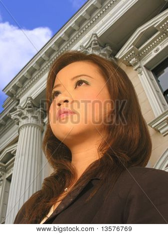 A photo of a lawyer coming out of a court   building