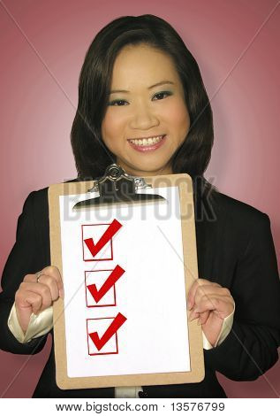 A photo of a woman holding a checklist