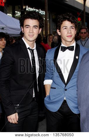 Kevin Jonas and Nick Jonas at the World premiere of 'Jonas Brothers: The 3D Concert Experience' held at the El Capitan Theater in Hollywood, USA on February 24, 2009.