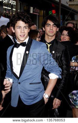 Nick Jonas and Joe Jonas at the World premiere of 'Jonas Brothers: The 3D Concert Experience' held at the El Capitan Theater in Hollywood, USA on February 24, 2009.