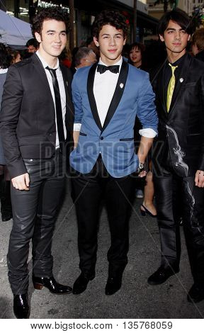 Kevin Jonas,Nick Jonas and Joe Jonas at the World premiere of 'Jonas Brothers: The 3D Concert Experience' held at the El Capitan Theater in Hollywood, USA on February 24, 2009.