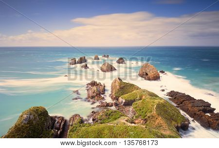 Long exposure shot of Nugget Point landscape, New Zealand.