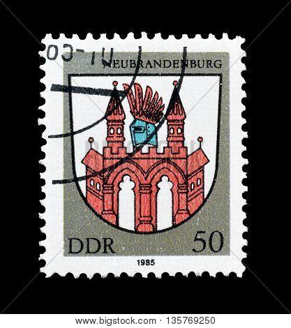 GERMAN DEMOCRATIC REPUBLIC - CIRCA 1985 : Cancelled postage stamp printed by German Democratic Republic, that shows  city arms of Neubrandenburg.