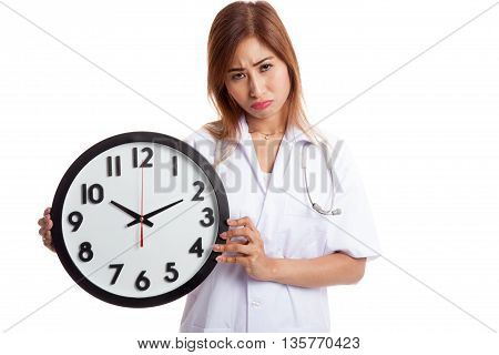 Frustrated Young Asian Female Doctor With A Clock