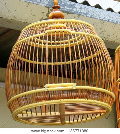 handmade bamboo bird cage hanging in a Songkhla pet shop, Thailand