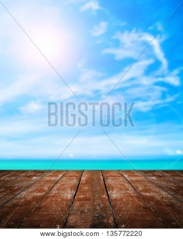 tropical beach with plank on blue sky background