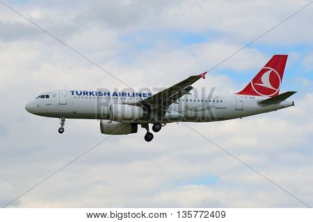 SAINT PETERSBURG, RUSSIA - MAY 17, 2016: Airbus A320-232 (TC-JPM) Turkish Airlines closeup on the background of cloudy sky