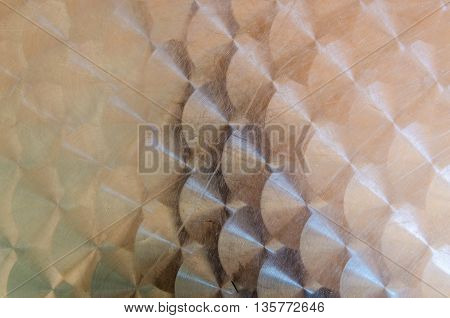 Metal background with copper colour circles texture