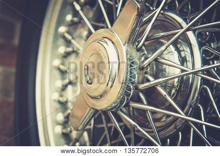 Close up of a vintage wheel with cross process effect