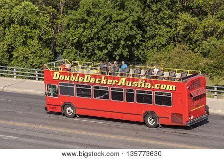 AUSTIN TX USA - APR 11: Sightseeing double decker bus in the city of Austin. April 11 2016 in Ausitn Texas United States