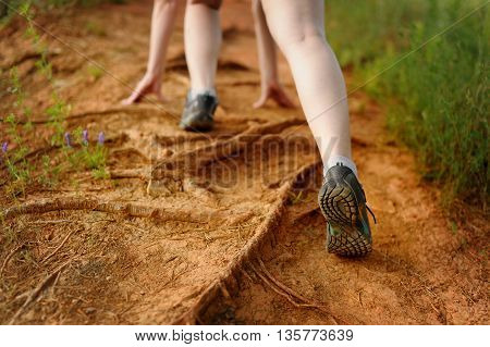 Concept: Woman's Legs In Motion On A Mountain Footpath.