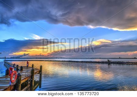 Sunset on the Chesapeake Bay in Maryland with the Key bridge and Baltimore on the horizon.