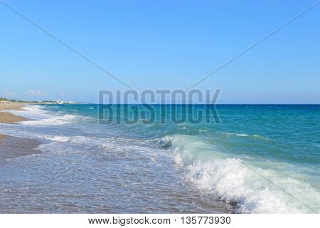 Beach with waves sea side view photo