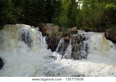 Two Waterfalls on a Creek Swelled To Very High Level Due to Snow Melt