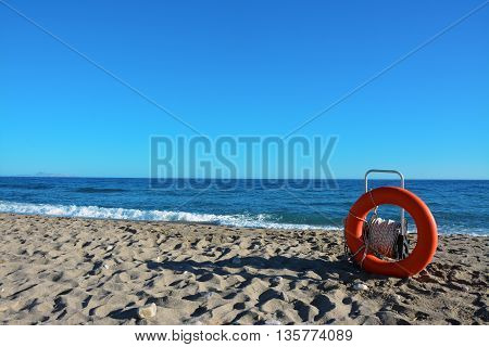A life preserver on a beach in a sunny day