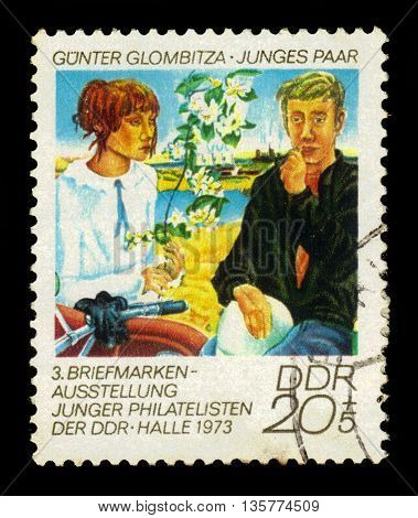GERMANY - CIRCA 1973: a stamp printed in the Germany, Democratic Republic (DDR)  shows young couple, painting by Gunter Glombitza, circa 1973