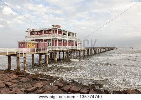 GALVESTON USA - APR 13: Fishing and leisure pier at the Gulf of Mexico coast in Galveston Island. April 13 2016 in Galveston Texas United States