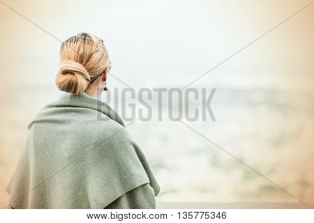 Back View Of A Woman With Tied Blond Hair..