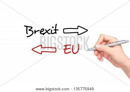 BREXIT. Human hand writing BREXIT on the screen.