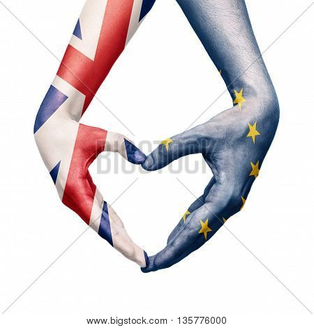 Hand patterned with the flag of the European Community envelops forming a heart with another hand patterned with the flag of the United Kingdom