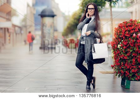 Urban  Woman With Shopping Bags Outside in The City