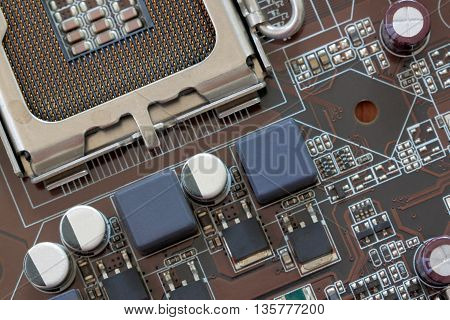 Socket electronics components on PC computer mainboard and have concept about technology.